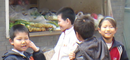 Hutong boy with itchy ear