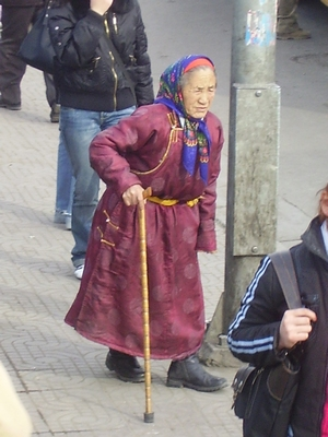 Old lady in traditional Mongolian clothes