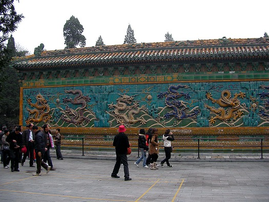 4 dragons on left side of wall plus centre yellow dragon