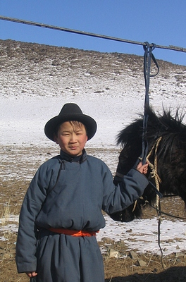 Mongolian boy with horse