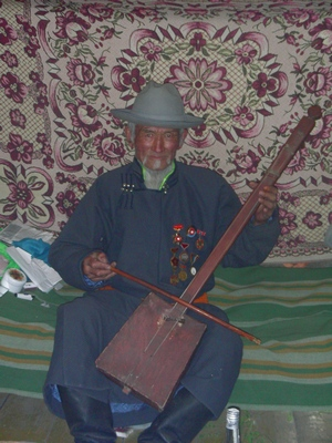 Mongolian man playing the morin khuur