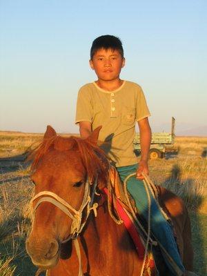 Mongolian boy on horse