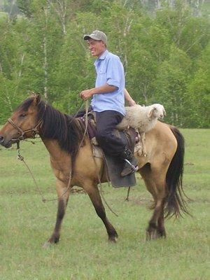 Grinning Mongolian cowboy