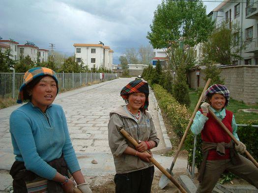 Young Tibetan women ditch-diggers