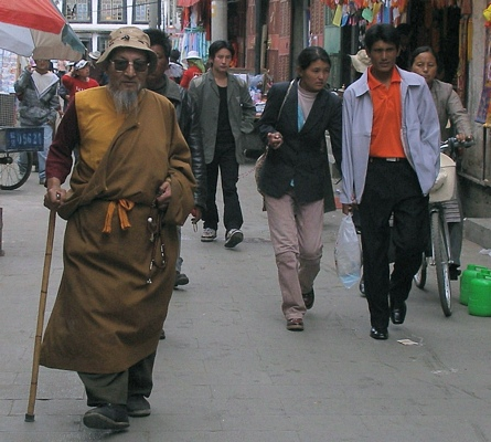 Old and young Tibetans walk the Barkor