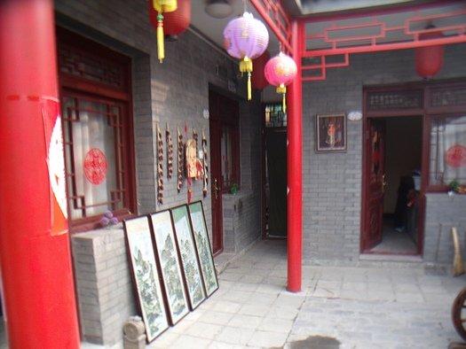 Narrow entryway to hutong courtyard