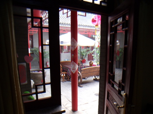 Looking out a hutong room door to the courtyard