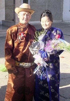 Couple in fancy Mongolian clothing
