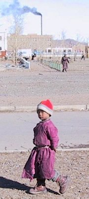 Mongolian boy with tattered deel